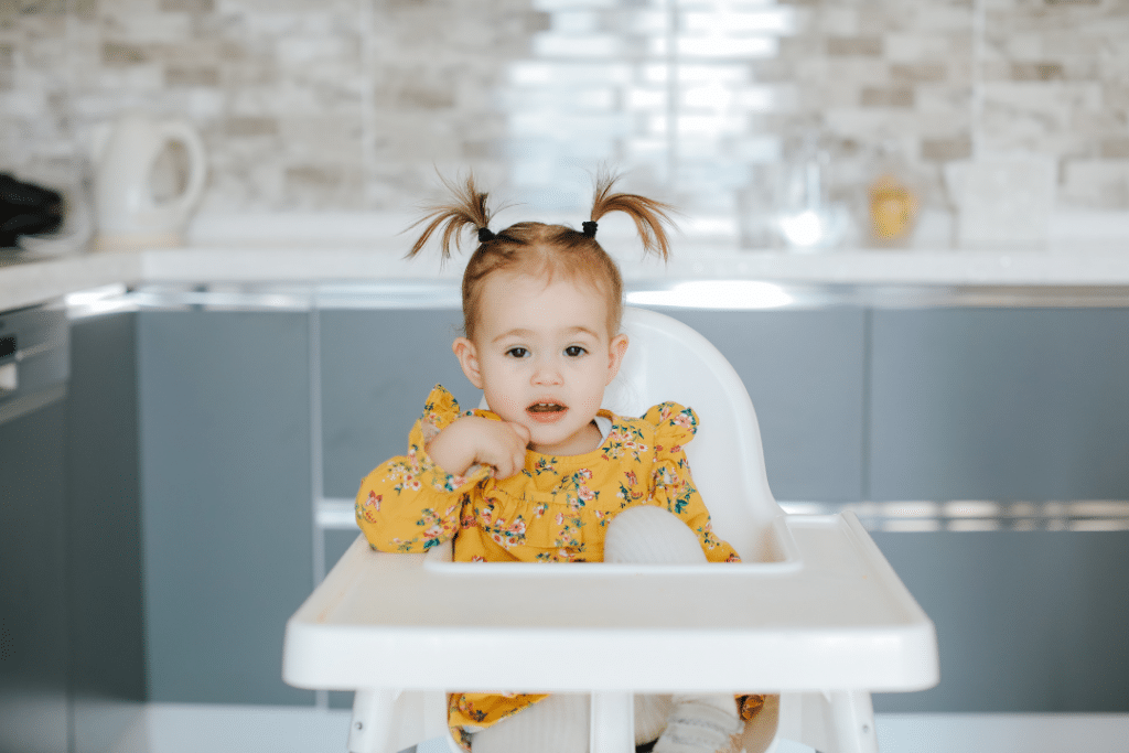 8 month old baby in a high chair
