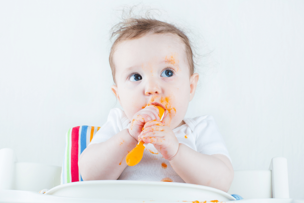 baby in high chair eating