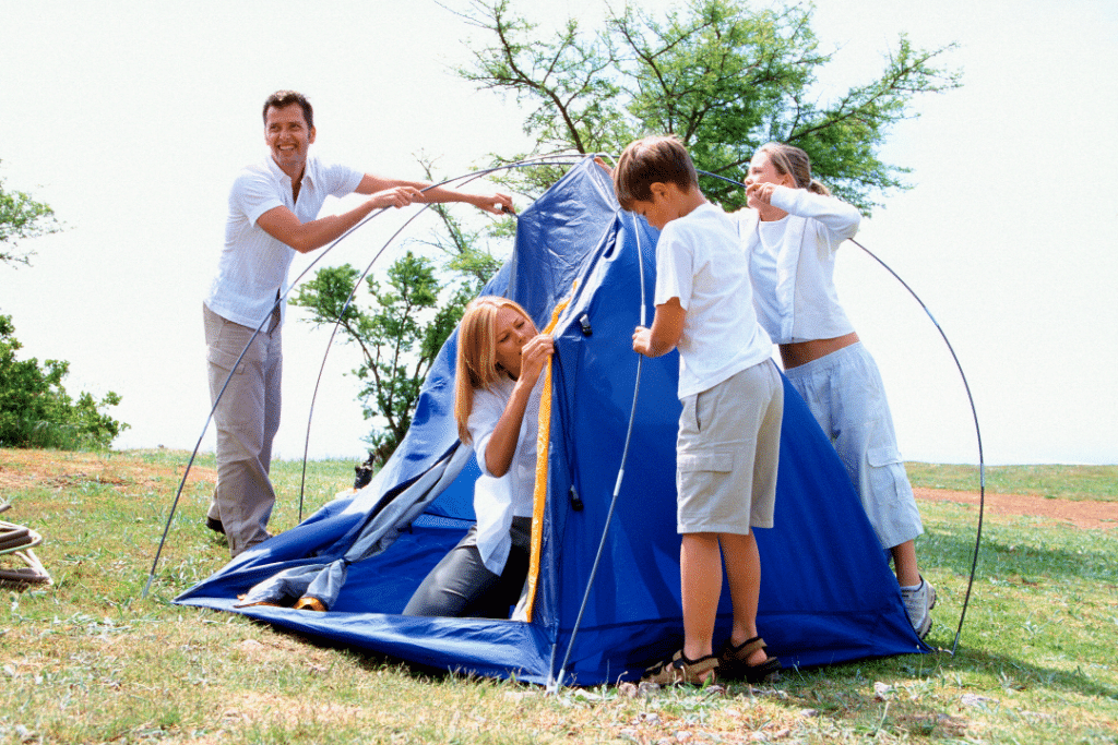family with food allergies setting up a camping tent