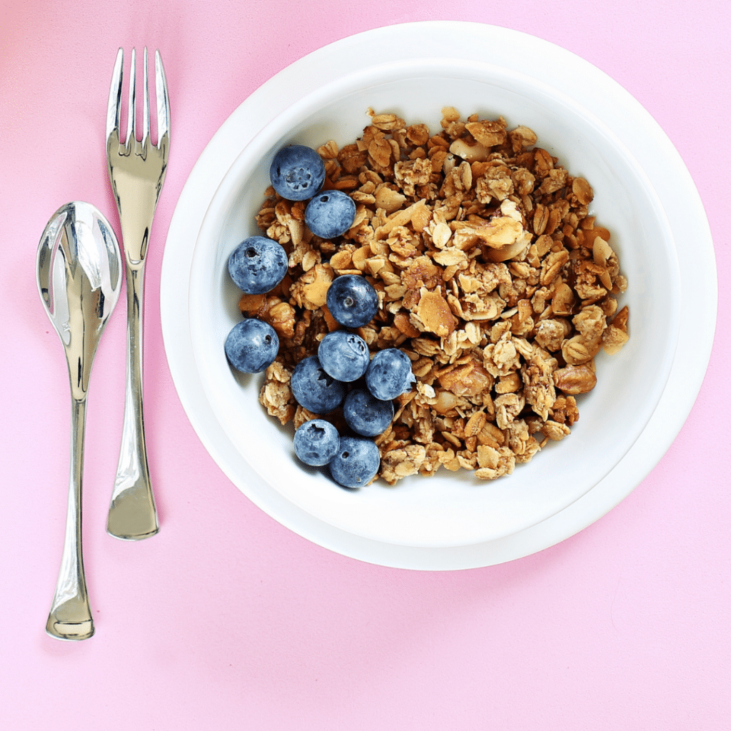 granola in a bowl with blueberries