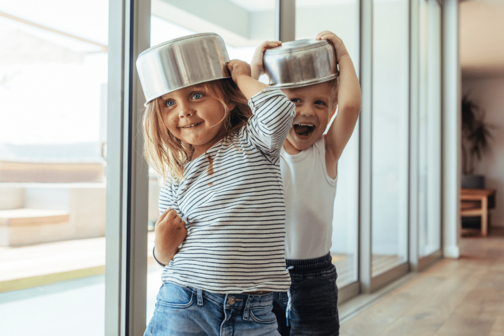 kids playing in kitchen with pots and pans
