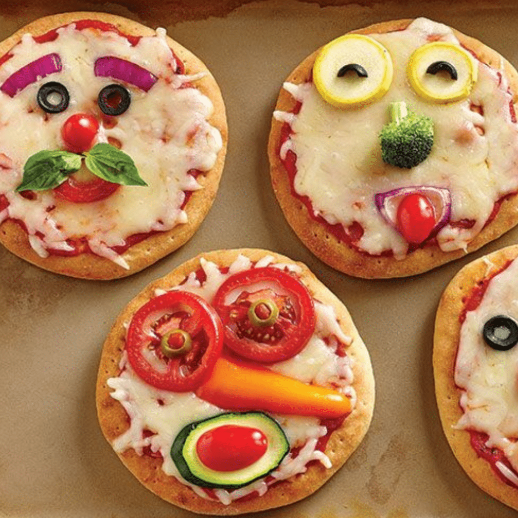 Pizzas with vegetable faces on them
