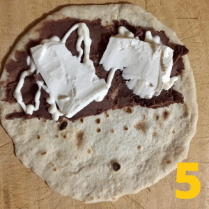 Step 5 Add queso fresco cheese to the tortilla