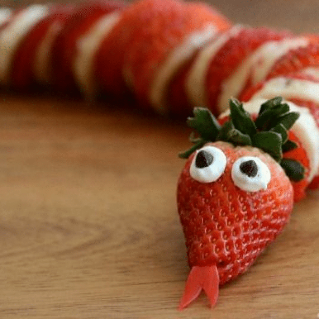 Fruit Snake made out of strawberries and a banana