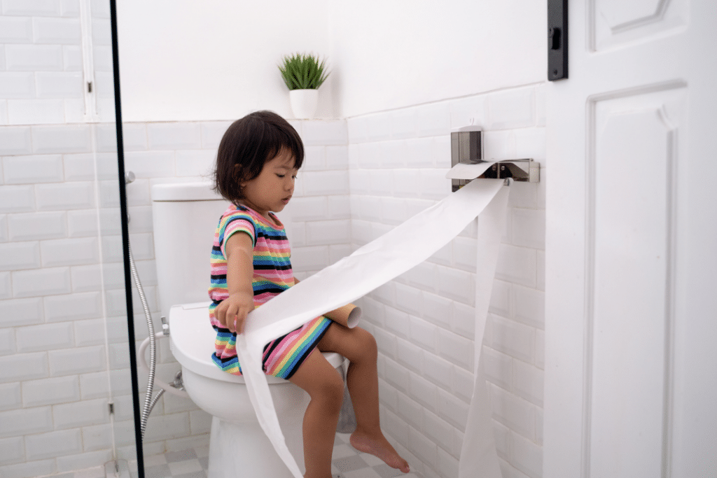 toddler playing with toilet paper, how to prevent a kid constipated