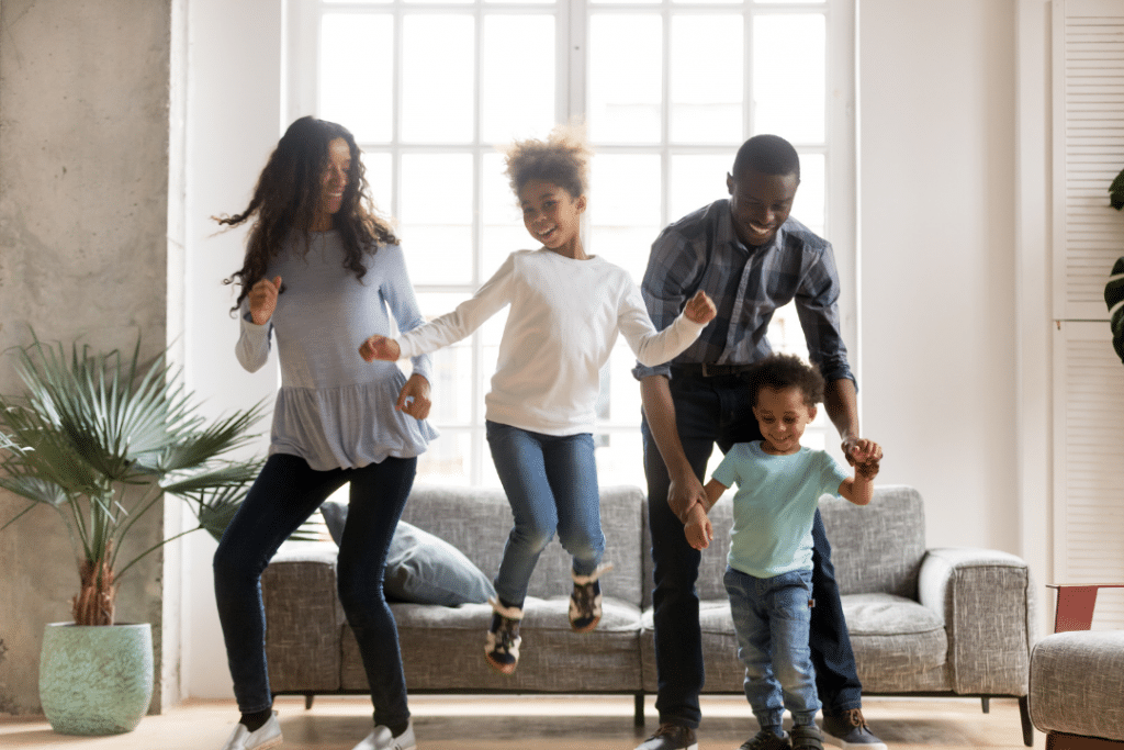 family jumping in living room