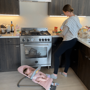 melissa chopping dates with baby in a bouncer