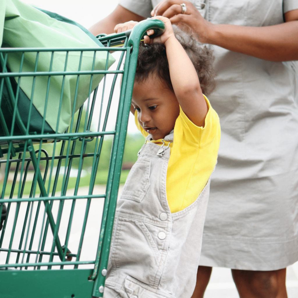 baby helping his mom shop